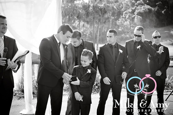 Loved this moment when job asks his junior groomsman to look after his sunglasses